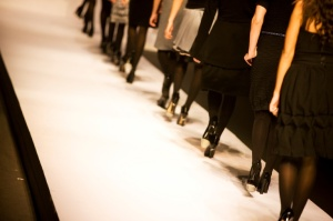 Female models walking on catwalk